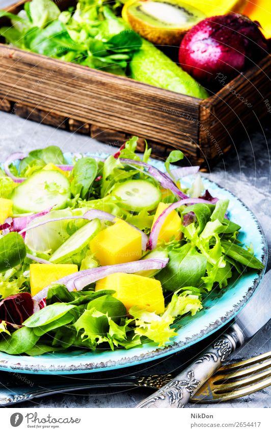 Vegetarian salad with vegetable and mango spring green lettuce vitamin leaf herb fresh food healthy diet vegetarian plate arugula natural cucumber fruit onion