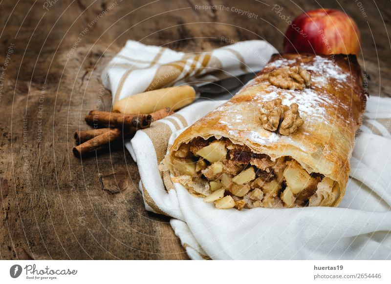 Homemade apple strudel with nuts Fruit Apple Dessert Candy Table Delicious food Sugar Home-made cake Baked goods stuffed Baking tasty kitchen Raisins roll