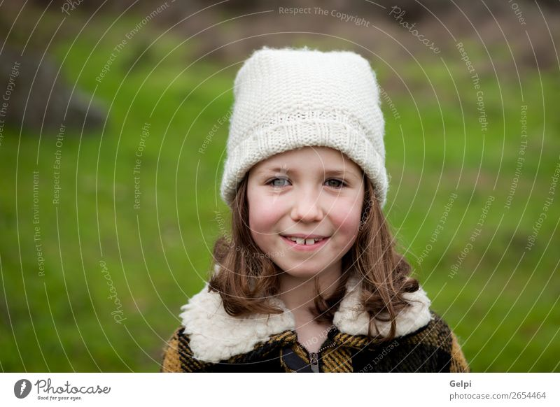 Pretty girl in a park at winter Joy Happy Beautiful Face Winter Garden Child Human being Toddler Woman Adults Family & Relations Infancy Nature Autumn Warmth