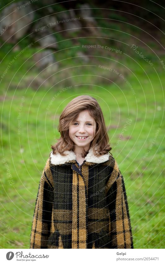 Beautiful girl with coat Joy Happy Face Winter Garden Child Human being Toddler Woman Adults Family & Relations Infancy Nature Autumn Warmth Grass Park Fashion