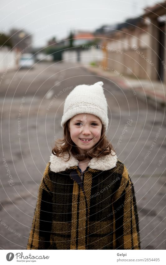 Beautiful girl with wool hat at winter Joy Happy Face Winter Child Human being Toddler Woman Adults Family & Relations Infancy Autumn Warmth Street Fashion Hat