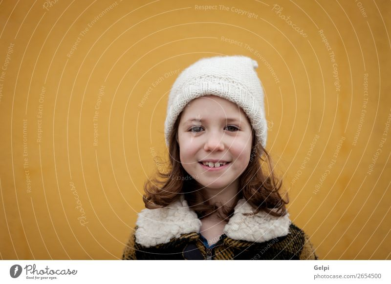 Pretty little girl in the street Woman Child Human being Beautiful White Joy Winter Face Street Adults Autumn Warmth Yellow Funny Family & Relations Happy