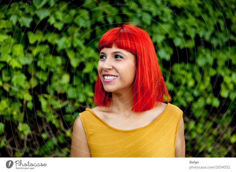 Happy red hair woman in a park Woman Human being Nature Summer Plant Colour Beautiful White Red Eroticism Calm Joy Face Lifestyle Adults Yellow