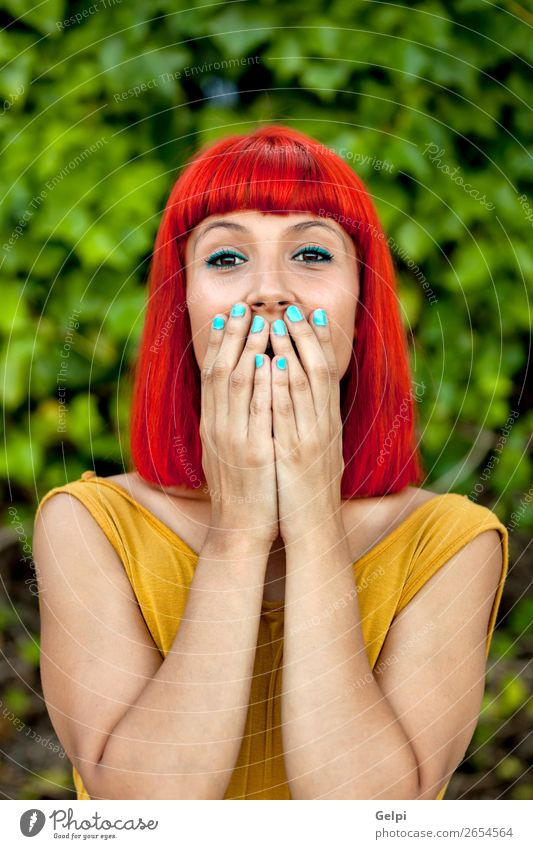 Surprised red haired woman in a park Woman Human being Nature Summer Plant Colour Beautiful White Red Eroticism Joy Face Lifestyle Adults Yellow Emotions