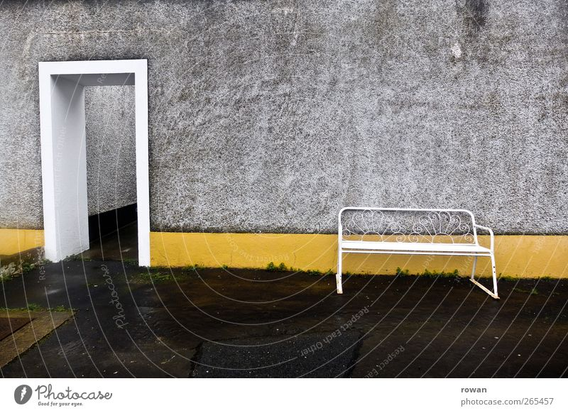 seating Manmade structures Building Architecture Wall (barrier) Wall (building) Facade Door Old Yellow Bench Wet Gloomy Loneliness Empty Entrance Asphalt Gray