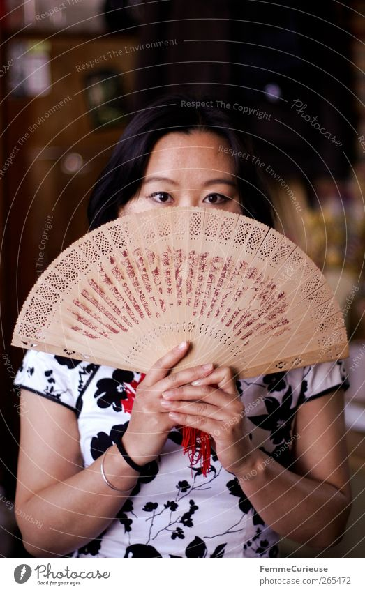 behind. Feminine Young woman Youth (Young adults) Woman Adults Arm Hand 1 Human being 18 - 30 years Culture Tradition Colour Guide wag fan Hide Indicate Asians