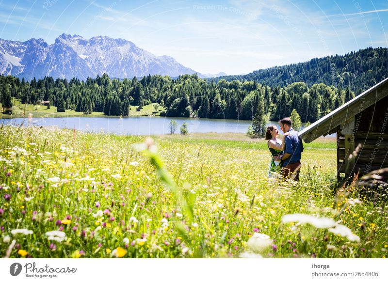 happy lovers on Holiday in the alps mountains Woman Human being Sky Vacation & Travel Nature Youth (Young adults) Man Summer Beautiful Green Landscape Flower