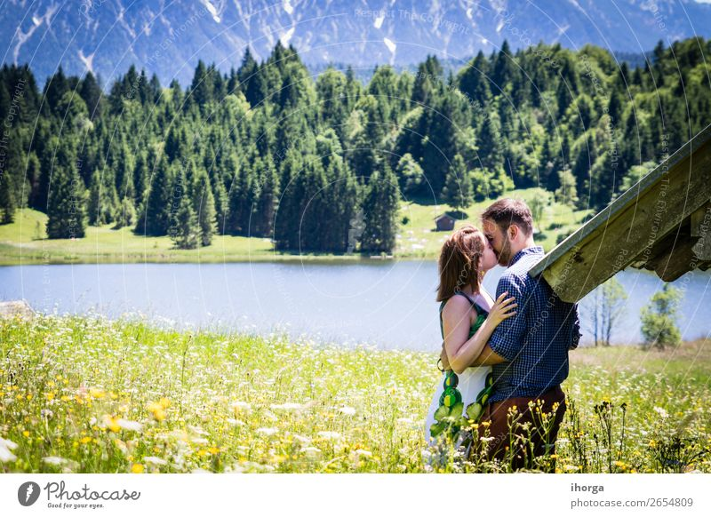 happy lovers on Holiday in the alps mountains Woman Human being Sky Vacation & Travel Nature Man Summer Beautiful Green Landscape Flower Relaxation Forest