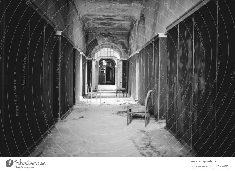 tunnel vision Chair Hallway Corridor Ruin Tunnel Wall (barrier) Wall (building) Door Old Threat Dirty Dark Broken Decline Past Transience Black & white photo