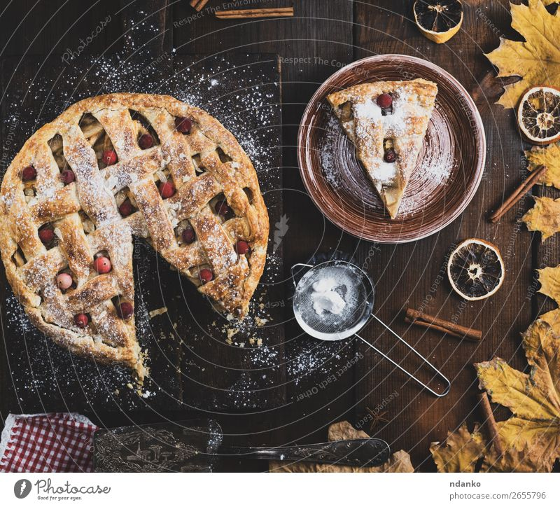 baked round apple pie and one cut piece on a plate Fruit Apple Cake Dessert Lunch Dinner Plate Table Kitchen Autumn Wood Eating Fresh Delicious Above Brown