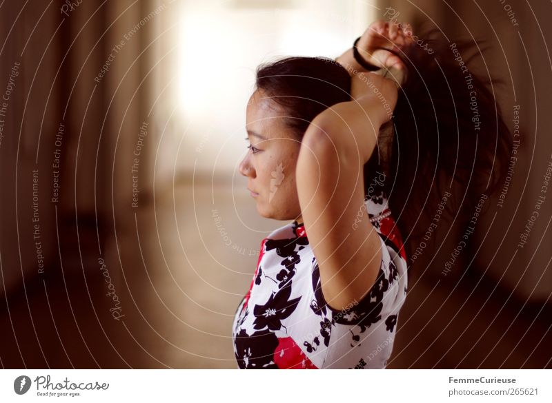 Woman tying back her hair. Feminine Young woman Youth (Young adults) Adults Head Arm 1 Human being 18 - 30 years Beautiful Thin Movement Braids Ponytail Bond