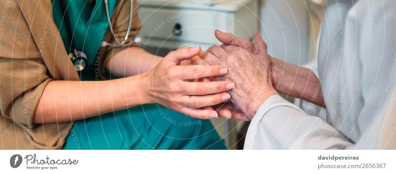 Doctor giving encouragement to elderly patient Woman Human being Old Hand Adults Religion and faith To talk Authentic Friendliness Internet Illness Medication