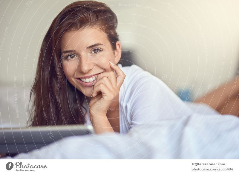 Pretty young woman with tablet in bed Shopping Happy Beautiful Bedroom Business Computer Technology Internet Woman Adults 1 Human being 18 - 30 years