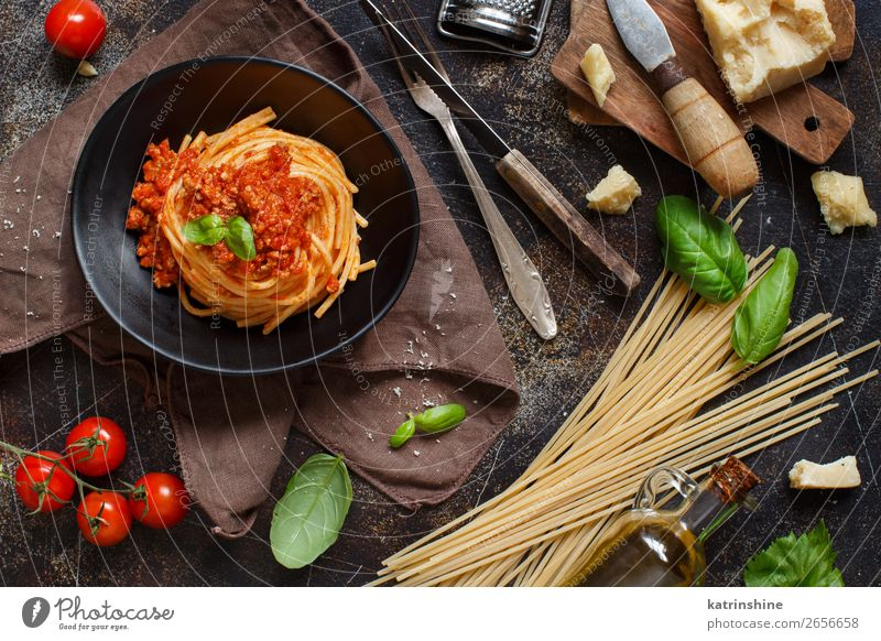 Spaghetti pasta with bolognese sauce Meat Cheese Herbs and spices Lunch Dinner Plate Fork Wood Bright Tradition Basil Beef Bolognese Cooking Dish food Italian