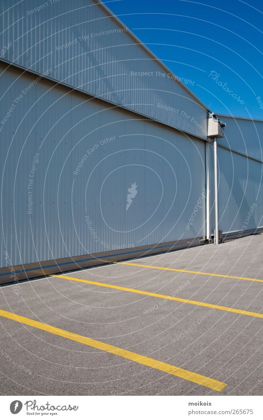 parking space Deserted Building Wall (barrier) Wall (building) Roof Stone Concrete Blue Yellow Gray Parking lot Hall Empty Colour photo Exterior shot