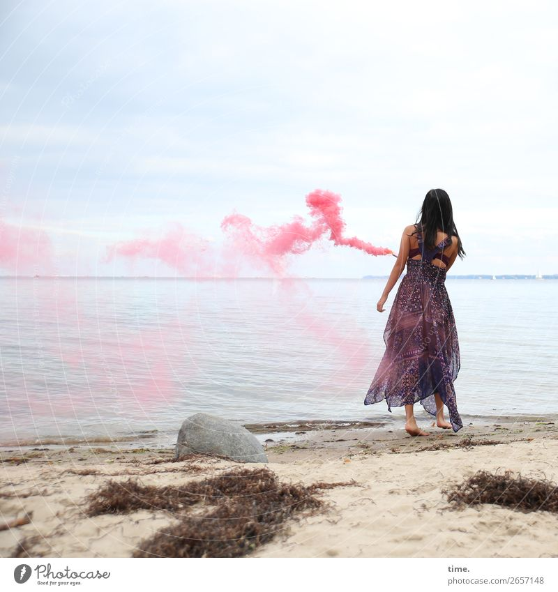 pink steam (III) Feminine Woman Adults 1 Human being Sand Sky Horizon Seaweed Coast Beach Baltic Sea Dress Black-haired Long-haired Torch Smoke Stone Movement