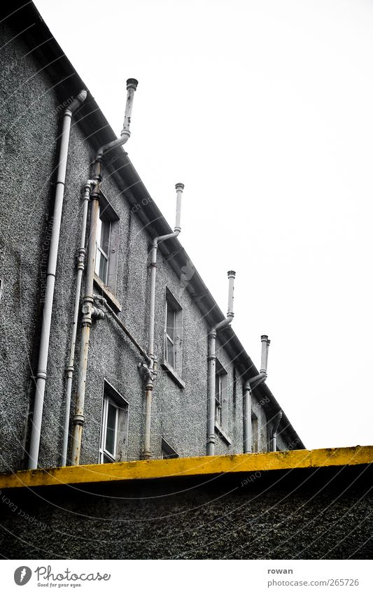 L Industrial plant Factory Manmade structures Building Architecture Wall (barrier) Wall (building) Facade Eaves Old Cold Broken Gloomy Town Yellow Dye Stripe