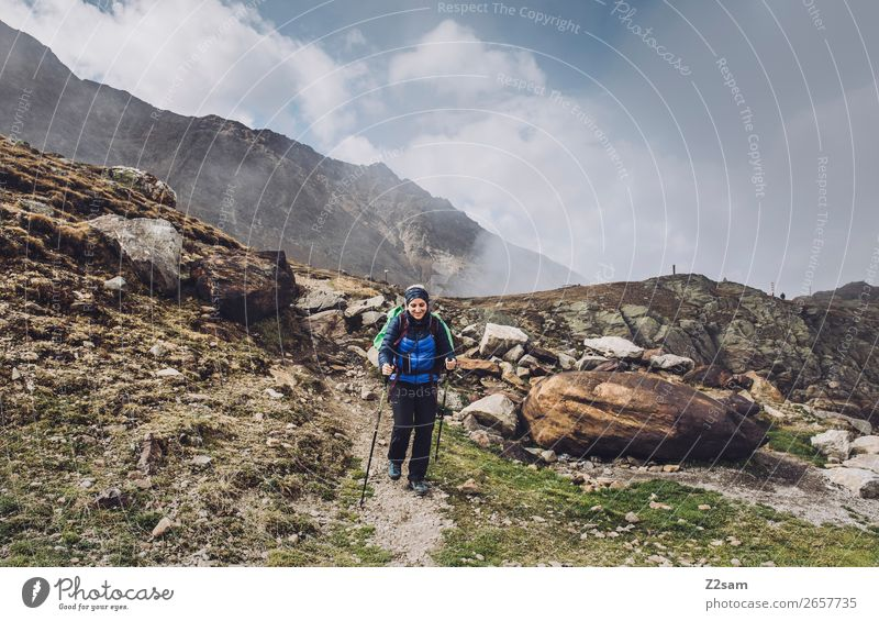 Young woman descending from Timmelsjoch | E5 Vacation & Travel Adventure Hiking Youth (Young adults) Nature Landscape Clouds Beautiful weather Alps Mountain