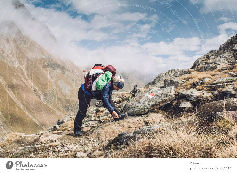 Young woman hiking | E5 Leisure and hobbies Vacation & Travel Adventure Hiking Youth (Young adults) Nature Landscape Clouds Autumn Beautiful weather Alps