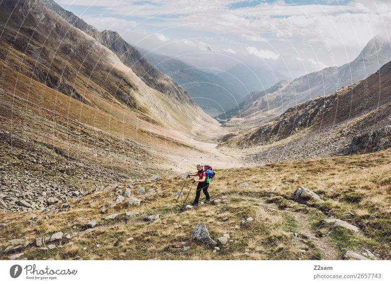 Young woman descending into Timmelstal | E5 Leisure and hobbies Adventure Hiking Youth (Young adults) 18 - 30 years Adults Nature Landscape Sky Clouds Autumn