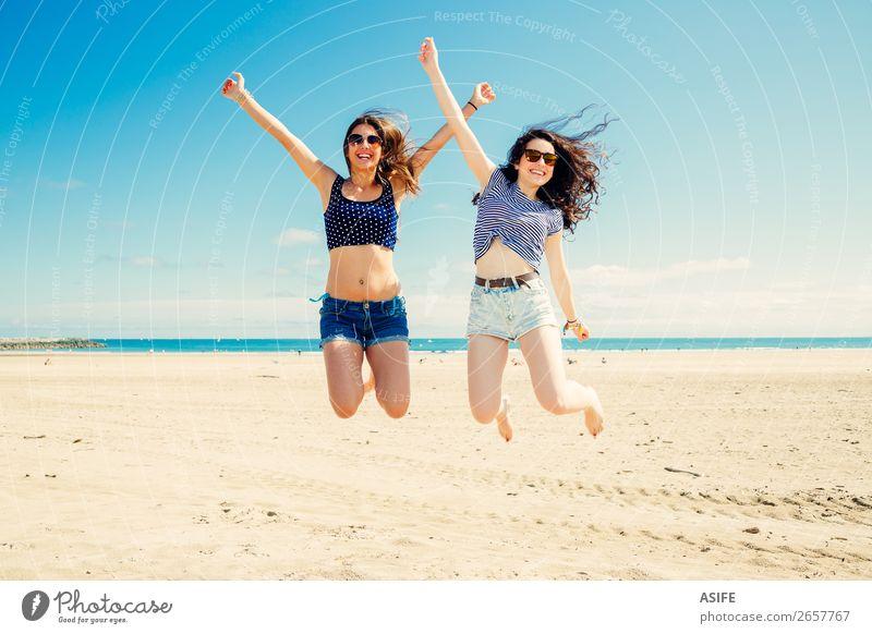 Funny girl frinds jumping on the beach Lifestyle Joy Happy Beautiful Vacation & Travel Tourism Summer Beach Ocean Woman Adults Friendship Sand Bikini Sunglasses