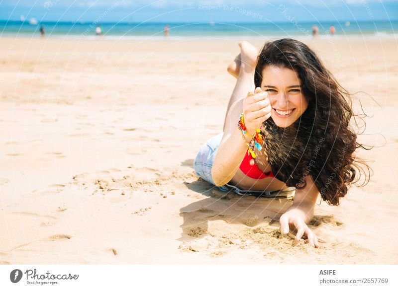 Happy young woman enjoying the beach Joy Beautiful Relaxation Playing Vacation & Travel Summer Sun Sunbathing Beach Ocean Woman Adults Hand Nature Sand Wind