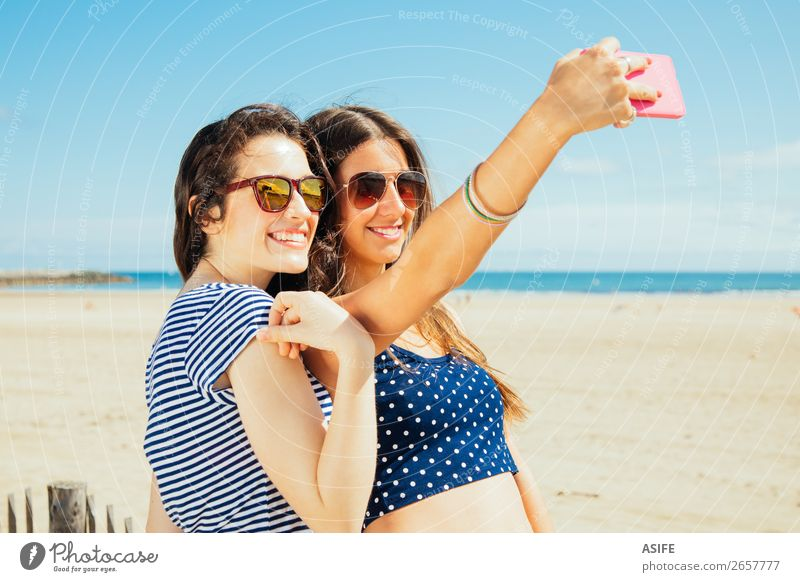 Holidays on the beach and selfies Joy Happy Vacation & Travel Tourism Summer Beach Ocean PDA Camera Technology Woman Adults Friendship Youth (Young adults)