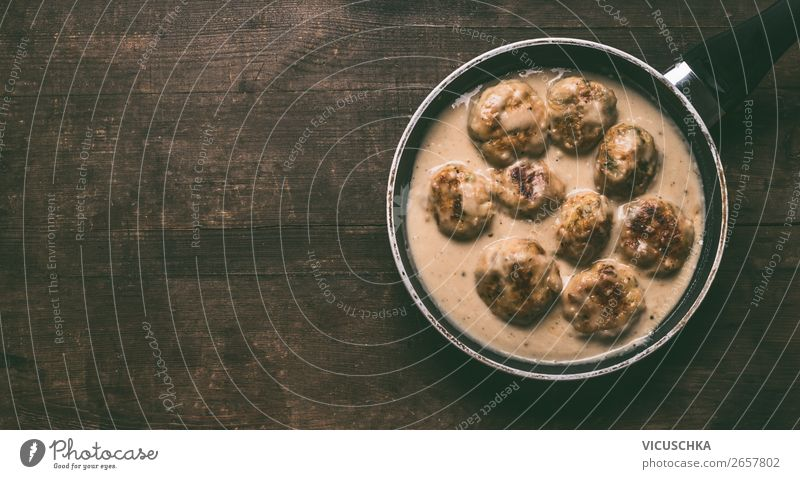 Homemade swedish chicken traditional meatballs in pan on dark rustic wooden background, top view with copy space homemade sauce cooked food dinner lunch beef