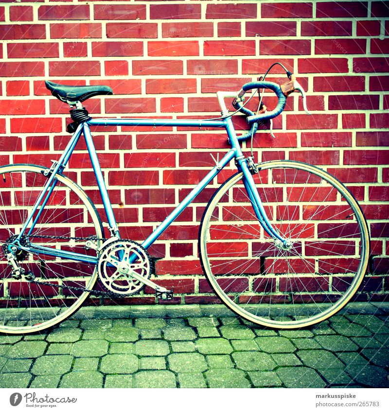 Bicycle Retro Section of image Partially visible Means of transport Object photography Brick wall Racing cycle Retro Colours Retro trash