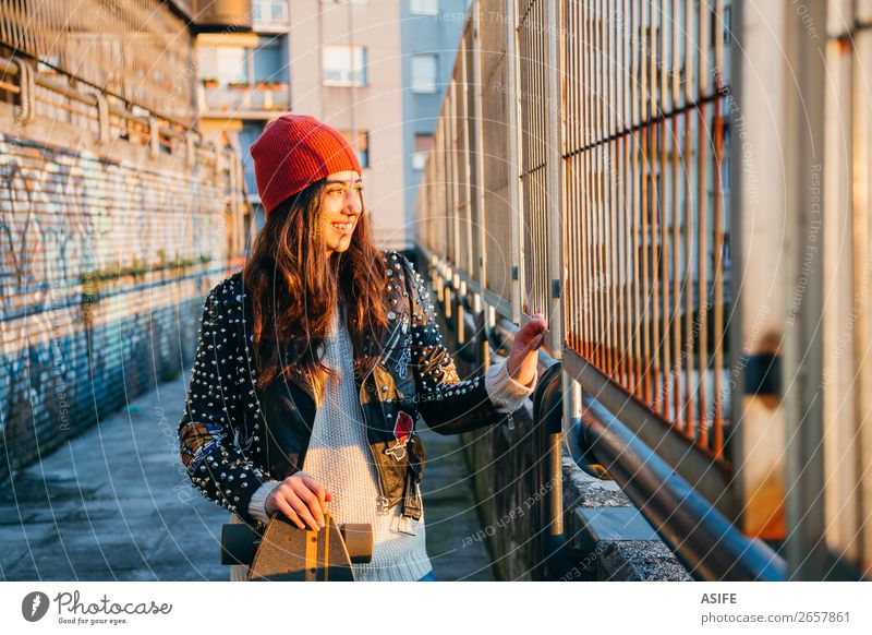 Skater woman at sunset Lifestyle Style Joy Happy Beautiful Leisure and hobbies Winter Sports Woman Adults Youth (Young adults) Culture Autumn Street Fashion Hat