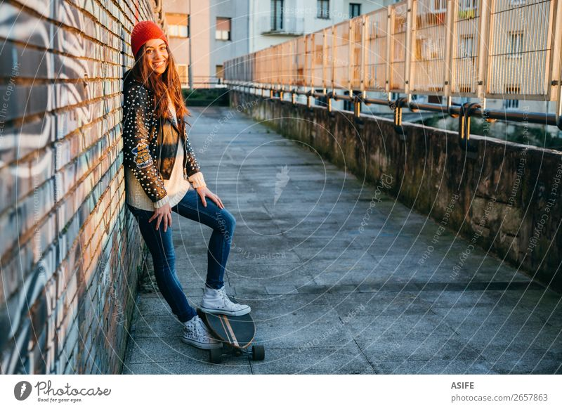 Skater woman at sunset enjoying the sun Lifestyle Style Joy Happy Beautiful Leisure and hobbies Winter Sports Woman Adults Youth (Young adults) Culture Autumn