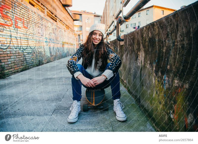 Skater woman sitting on longboard Lifestyle Style Joy Happy Beautiful Leisure and hobbies Winter Sports Woman Adults Youth (Young adults) Culture Autumn Street