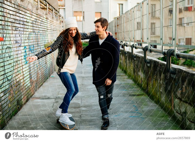 Funny couple learning to skate Lifestyle Style Joy Happy Beautiful Winter Sports School Woman Adults Man Couple Youth (Young adults) Culture Autumn Street