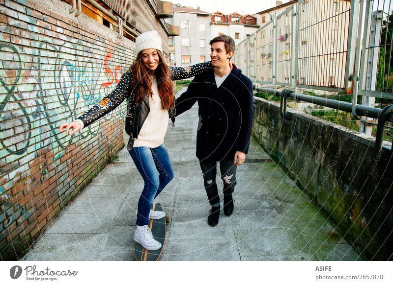 Funny couple learning to skate Woman Youth (Young adults) Man Beautiful Joy Winter Street Lifestyle Adults Graffiti Autumn Love Sports Happy Style