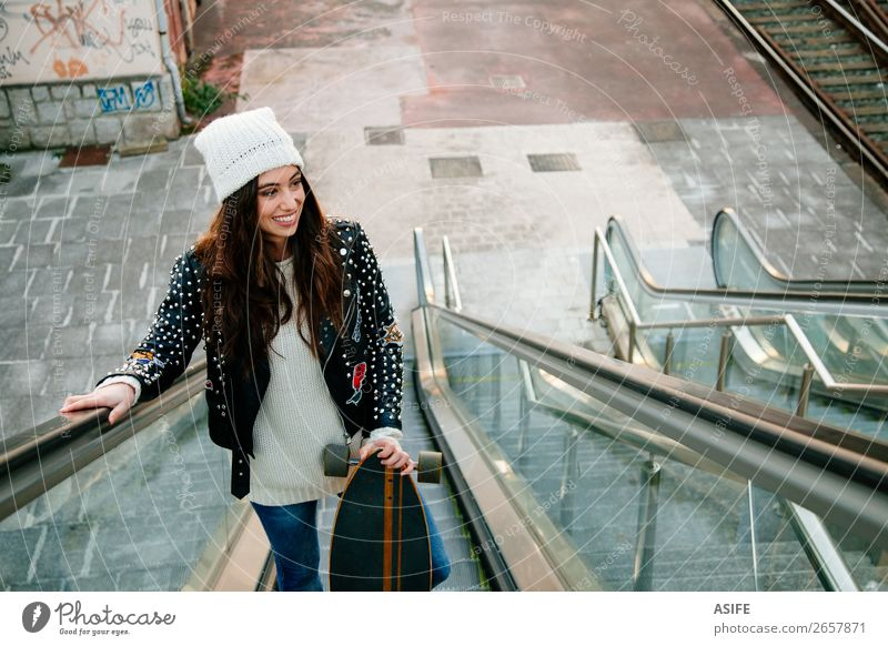 Beautiful skate woman on the scalator Woman Youth (Young adults) Joy Winter Street Lifestyle Adults Autumn Sports Happy Style Fashion Leisure and hobbies