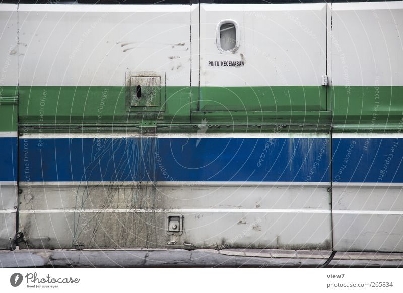 bus Wall (barrier) Wall (building) Facade Vehicle Bus Metal Line Stripe Old Authentic Simple Disgust Modern Gloomy Crazy Blue Multicoloured Green Beginning