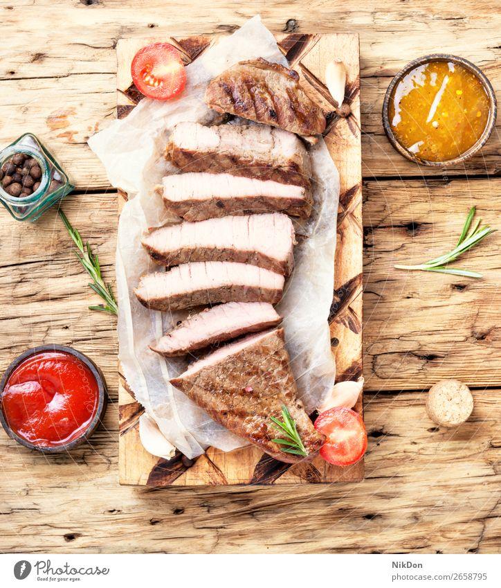 Sliced beef steak sliced meat food grilled rosemary barbecue roasted beefsteak board medium tenderloin sirloin piece cutting ham smoked brisket succulent
