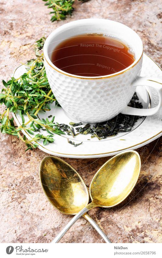 Herbal tea with thyme herbal healthy drink green leaf cup beverage natural flower plant glass organic medicine fresh aroma breakfast petal medicinal spoon