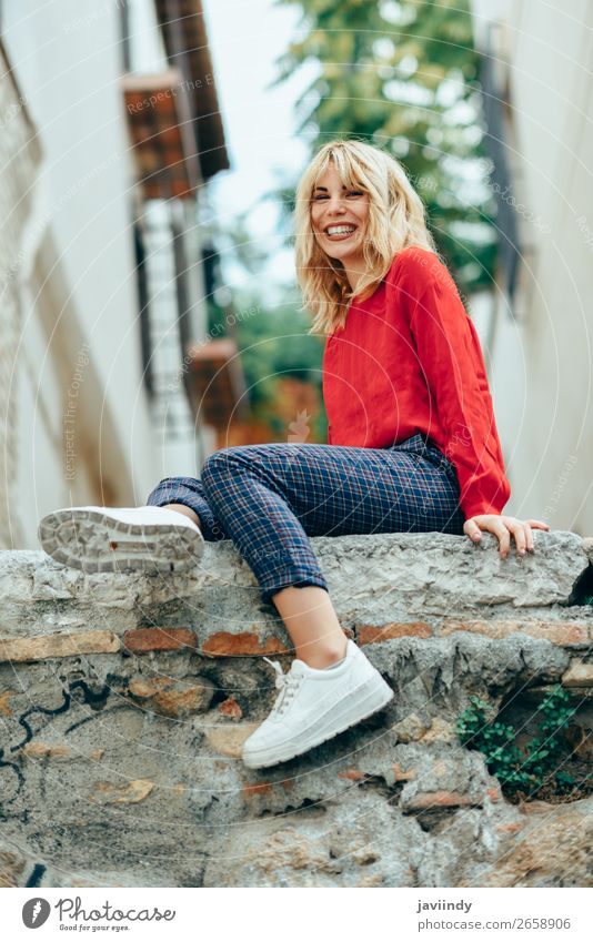 Smiling blonde girl with red shirt enjoying life outdoors Woman Human being Youth (Young adults) Young woman Beautiful White Red Joy 18 - 30 years Street