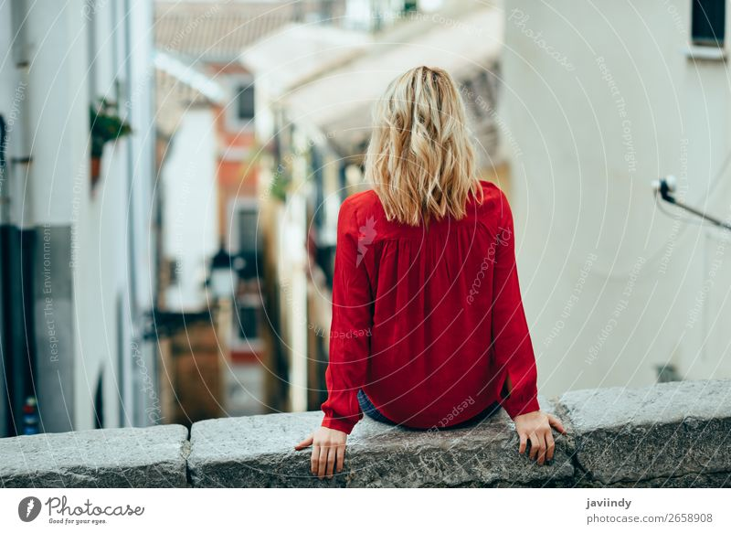 Young woman sitting outdoors looking a beautiful narrow street Woman Human being Youth (Young adults) Beautiful White 18 - 30 years Street Lifestyle Adults