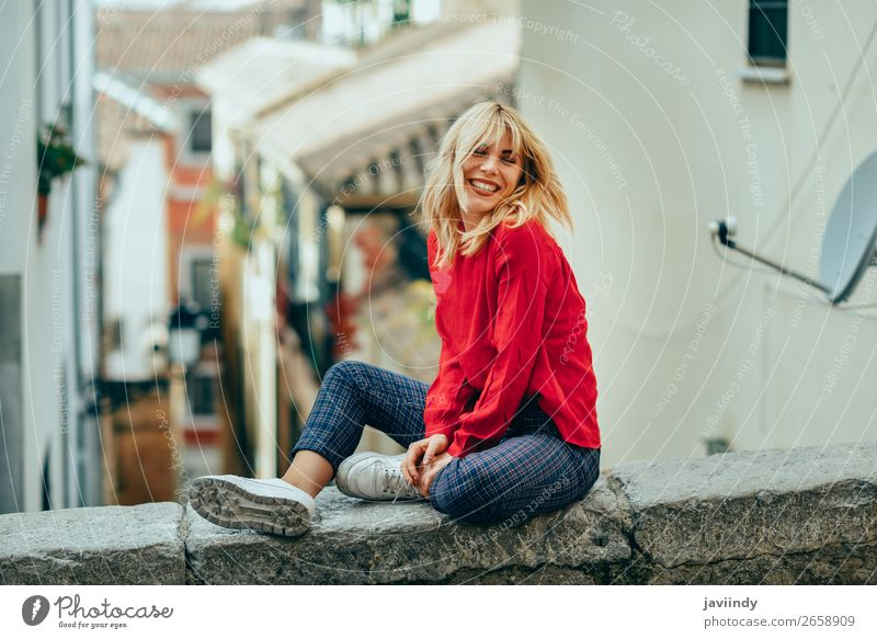 Smiling blonde girl with red shirt enjoying life outdoors. Woman Human being Youth (Young adults) Young woman Beautiful White Red Joy 18 - 30 years Street