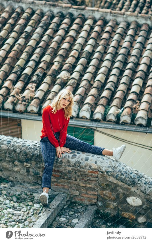 Young woman sitting near beautiful roofs of charming old houses Woman Human being Youth (Young adults) Beautiful White Red 18 - 30 years Street Lifestyle Adults
