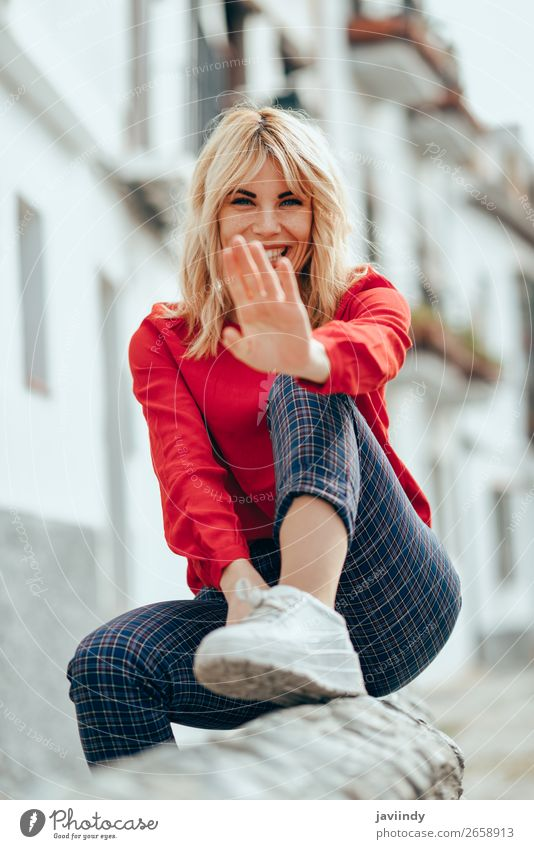 Woman sitting outdoors putting her hand near the camera. Lifestyle Beautiful Hair and hairstyles Human being Feminine Young woman Youth (Young adults) Adults 1