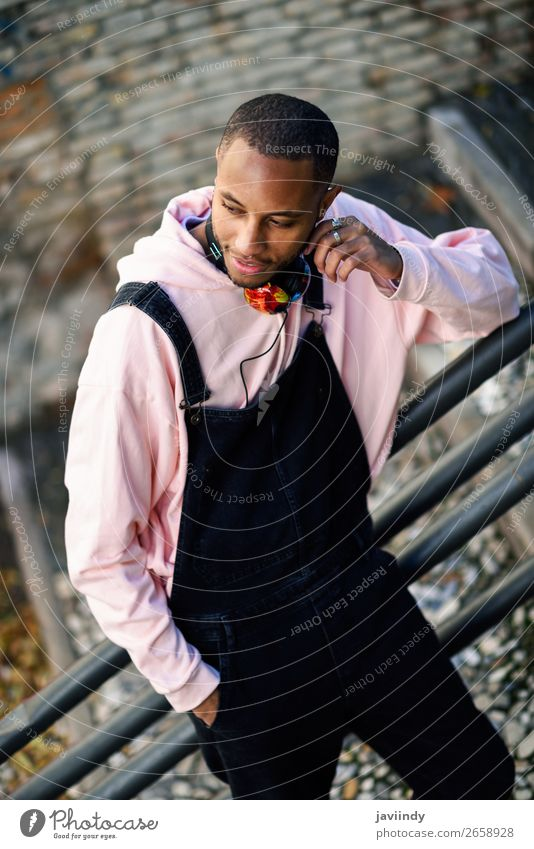 Smiling black man wearing casual clothes outdoors Lifestyle Happy Beautiful Human being Masculine Young man Youth (Young adults) Man Adults 1 18 - 30 years