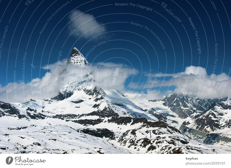 Matterhorn in Clouds II Mountain Elements Sky Ice Frost Snow Rock Alps Peak Snowcapped peak Glacier Gigantic Large Cold Blue White Climate Zermatt Gornergrat