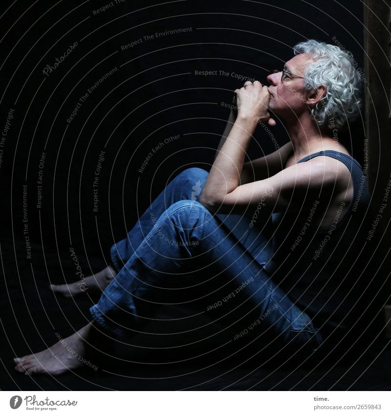 man in thoughts Attic Masculine Man Adults 1 Human being T-shirt Jeans Eyeglasses Barefoot Gray-haired Curl Observe Think To hold on Looking Sit Authentic Dark