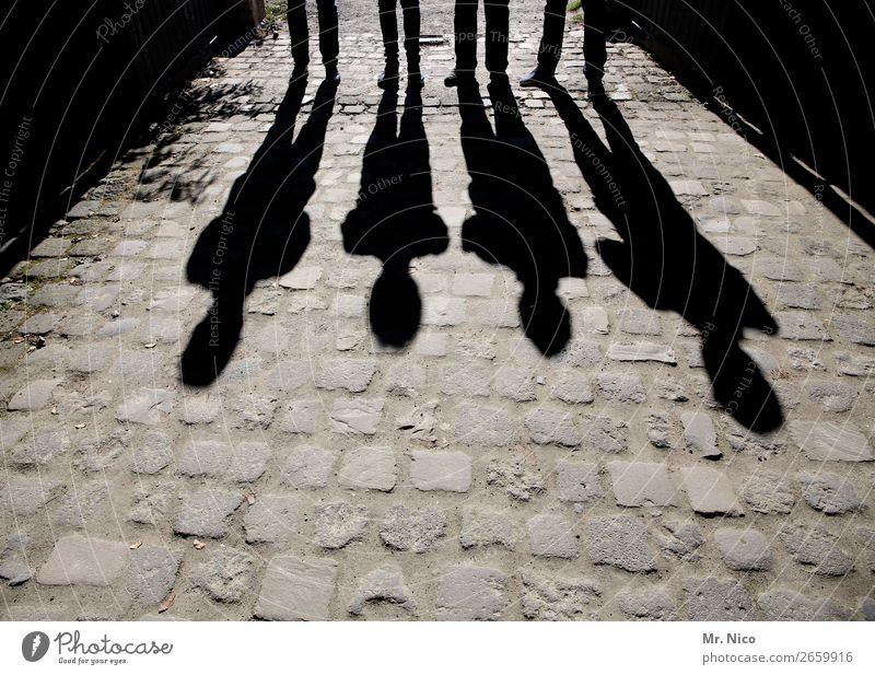 shadow of a man Masculine 4 Human being Stand Paving stone Black Shadow play Posture Abstract Group Contrast Silhouette Light Gray Lighting effect Exceptional