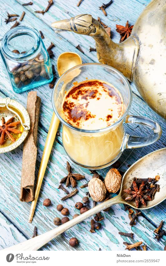 Masala tea with spices masala cup ingredient milk anise cinnamon drink ginger kettle beverage chai healthy indian stick glass warm organic spiced flavor