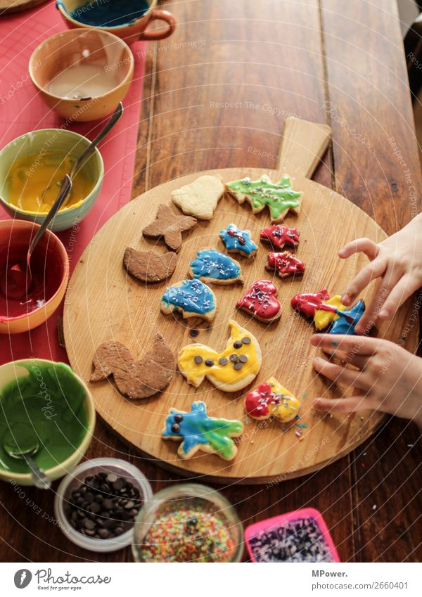 it starts again :-) Food Human being Hand Work and employment Baking Christmas biscuit Cookie Multicoloured Sweet Table Pierce Decoration Children`s hand Icing