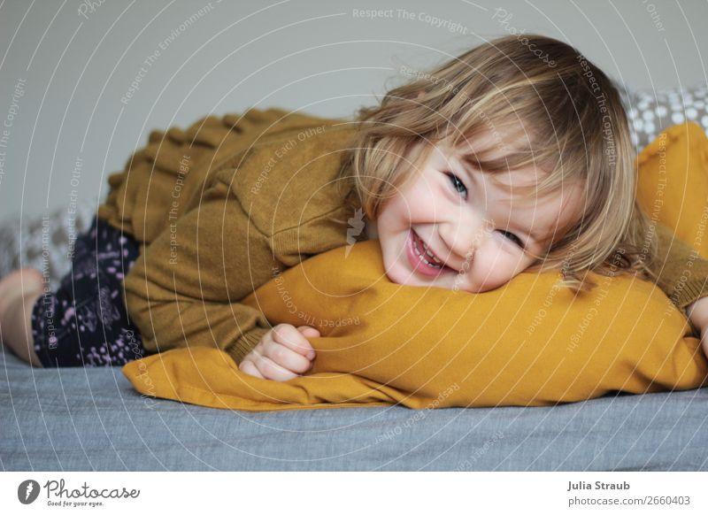 Human being Joy Girl Natural Funny Feminine Movement Laughter Gray Lie Blonde Infancy Happiness Joie de vivre (Vitality) Cute Friendliness